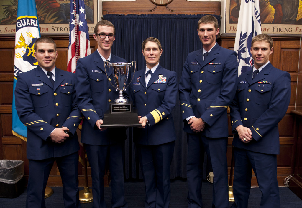 Rear Adm. Sandra Stosz of the USCGA receives trophy from Combat Arms Team