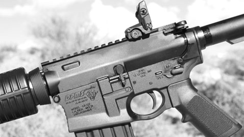 The DPMS logo is prominent on the left side of the GII AP4's receiver, as is its large magazine well mouth.