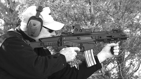 Johnston kneels to engage a far off steel target on Gunsite's Trail Walk.  The ACR-PDW performed superbly.